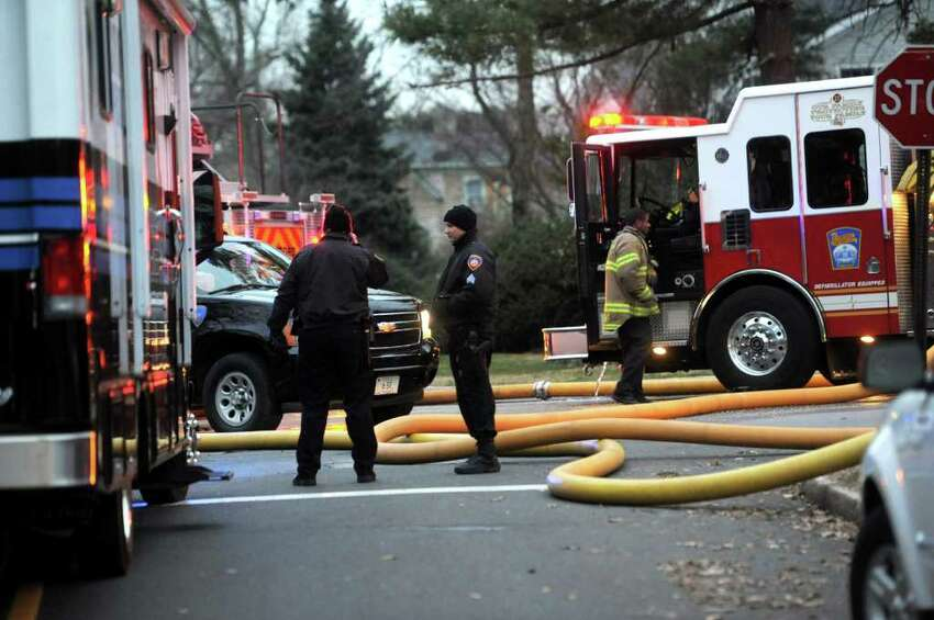 Police officers and firefighters respond to a fire on Shippan Ave. in Stamford on Christmas morning, Sunday, December 25, 2011. According to a brief statement my Mayor Pavia, the fire claimed the lives of five people, including three children.