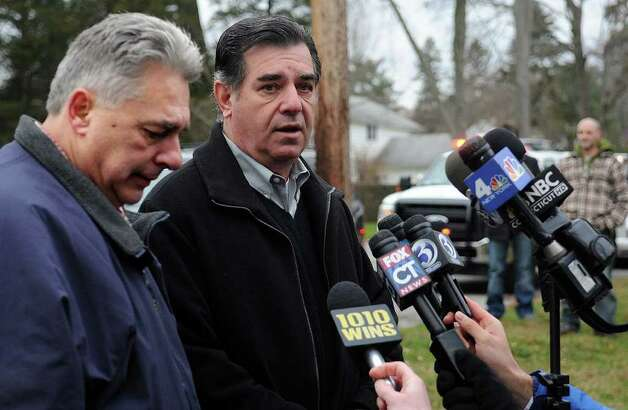 Mayor Michael Pavia, right and Stamford Fire Chief Antonio Conte, left, give a statement regarding a house fire on Shippan Ave. in Stamford on Christmas day, Sunday, December 25, 2011. Conte told the media that firefighters tried to rescue the occupants of the house, but heavy smoke and high heat kept them from reaching five people who died, including three children. Photo: Lindsay Niegelberg / Stamford Advocate