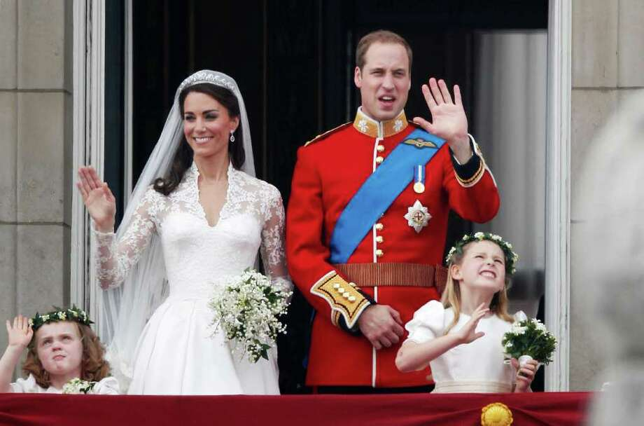 LONDON, ENGLAND - APRIL 29:  TRH Catherine, Duchess of Cambridge and Prince William, Duke of Cambridge greet well-wishers from the balcony at Buckingham Palace on April 29, 2011 in London, England. The marriage of the second in line to the British throne was led by the Archbishop of Canterbury and was attended by 1900 guests, including foreign Royal family members and heads of state. Thousands of well-wishers from around the world have also flocked to London to witness the spectacle and pageantry of the Royal Wedding.  (Photo by Christopher Furlong/Getty Images) Photo: Christopher Furlong, Getty Images / 2011 Getty Images
