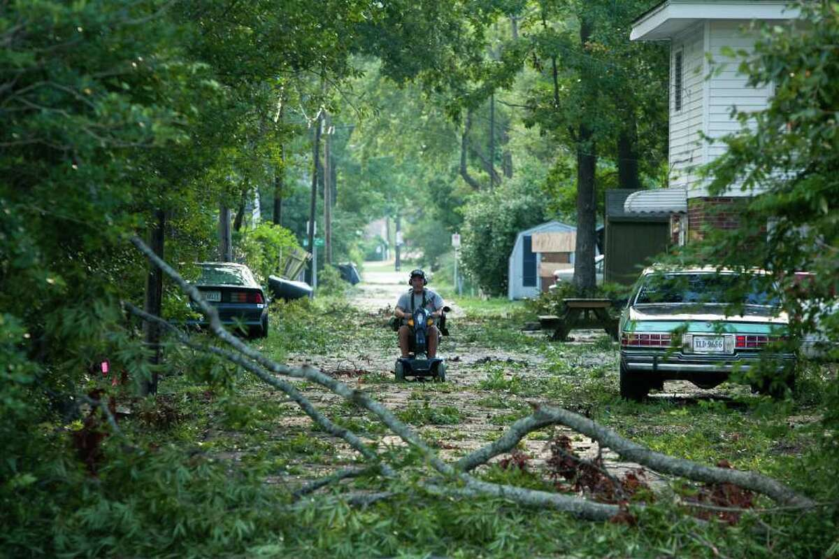 VIRGINIA BEACH, VA - AUGUST 28: Branches litter an alley as a result of Hurricane Irene on August 28, 2011 in Virginia Beach, VA. The hurricane made landfall in North Carolina and Virginia early Saturday morning and has now moved further up the east coast to New Jersey and is on course to hit New York later today. The storm has claimed the lives of eight people so far. (Photo by Brendan Hoffman/Getty Images)