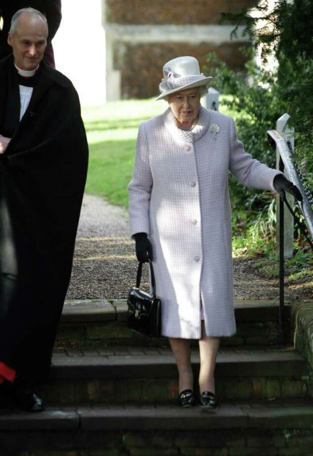 Britain's Queen Elizabeth II, right, leaves after she and other members of the royal family attended a Christmas Service at St. Mary's church on the grounds of Sandringham Estate, the Queen's Norfolk retreat, England, Sunday, Dec. 25, 2011. (AP Photo/Lefteris Pitarakis) Photo: Lefteris Pitarakis / AP