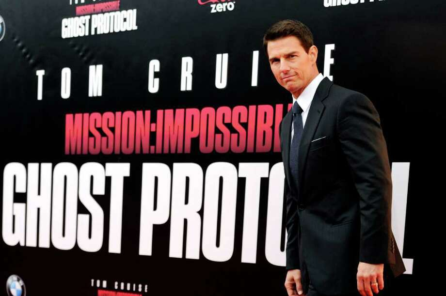 """Actor Tom Cruise attends the U.S. premiere of """"Mission: Impossible - Ghost Protocol"""" at the Ziegfeld Theatre on Monday, Dec. 19, 2011 in New York. (AP Photo/Evan Agostini) Photo: Evan Agostini"""