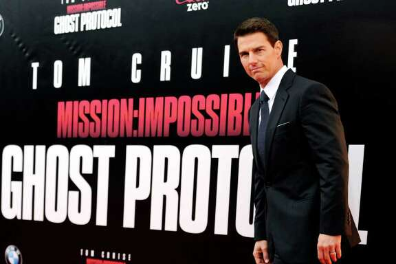 "Actor Tom Cruise attends the U.S. premiere of ""Mission: Impossible - Ghost Protocol"" at the Ziegfeld Theatre on Monday, Dec. 19, 2011 in New York. (AP Photo/Evan Agostini)"