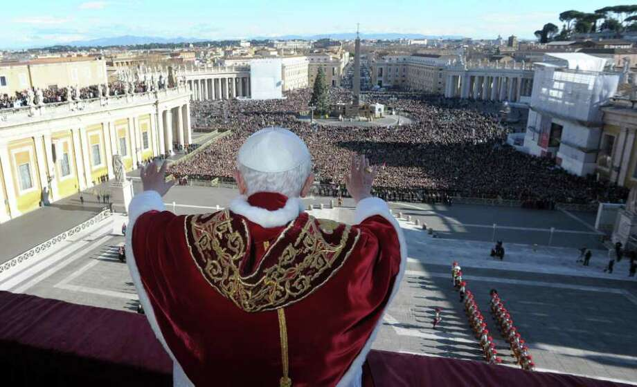 "Pope Benedict XVI delivers his ""Urbi et Orbi"" (to the City and to the World) speech from the central loggia of St. Peter's Basilica, at the Vatican on Christmas day. Photo: ASSOCIATED PRESS / L'Osservatore Romano"