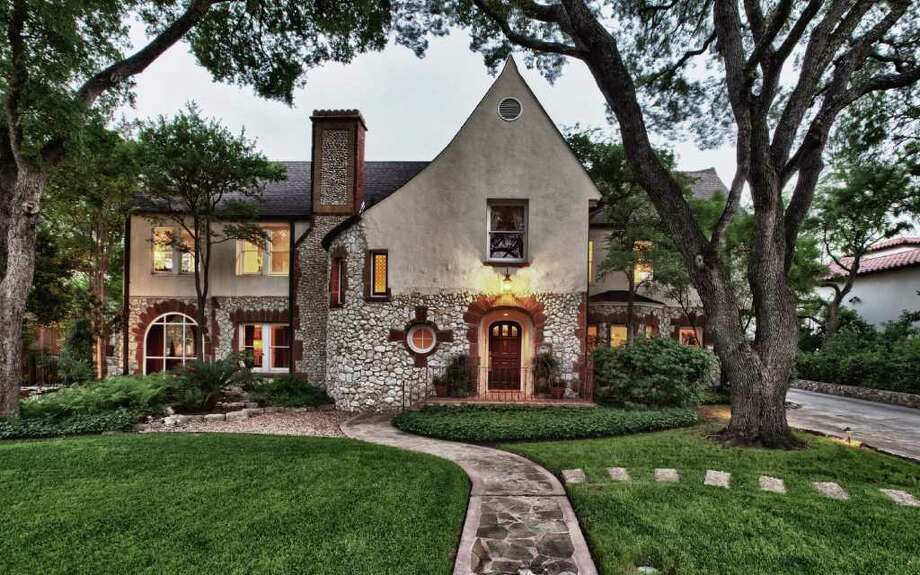 This Tudor home in Olmos Park has three bedrooms, 4½ bathrooms, a pool, sunroom, two fireplaces and a maid's quarters. It is listed at $1.295 million. Photo: COURTESY PHOTO / Photo courtesy of Kuper Sotheby's International Realty.