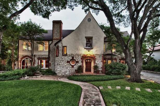 This Tudor home in Olmos Park has three bedrooms, 4½ bathrooms, a pool, sunroom, two fireplaces and a maid's quarters. It is listed at $1.295 million.