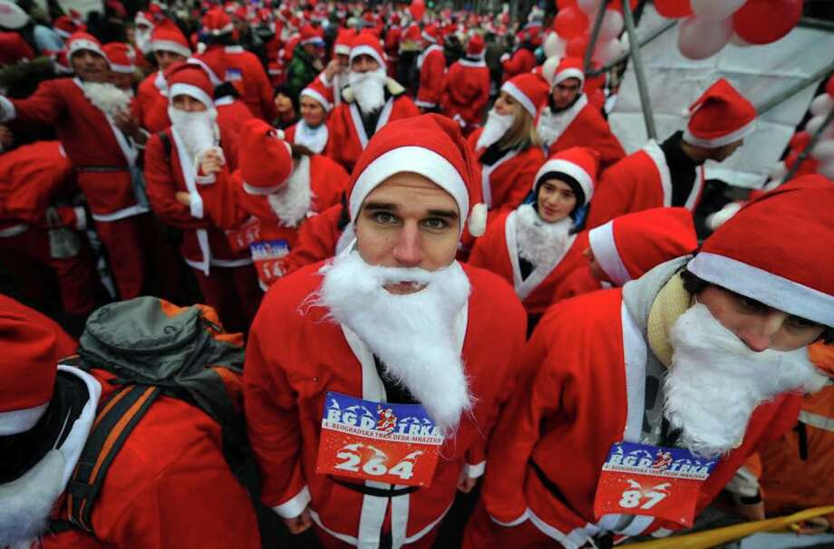 People dressed as Santa Claus prepare for the traditional Christmas race in downtown Belgrade on December 25, 2011. Photo: ANDREJ ISAKOVIC, Getty / AFP