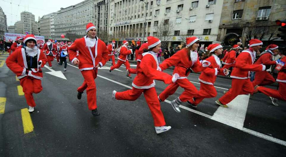 People dressd as Santa Claus take part in the traditional Christmas race in downtown Belgrade on Dec