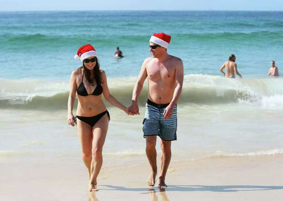 Vivian Vasso and Ben Cheathan stroll hand in hand from the water at Bondi Beach on December 25, 2011 in Sydney, Australia. Bondi Beach is a popular place for tourists on Christmas Day. Photo: Don Arnold, Getty / 2011 Getty Images