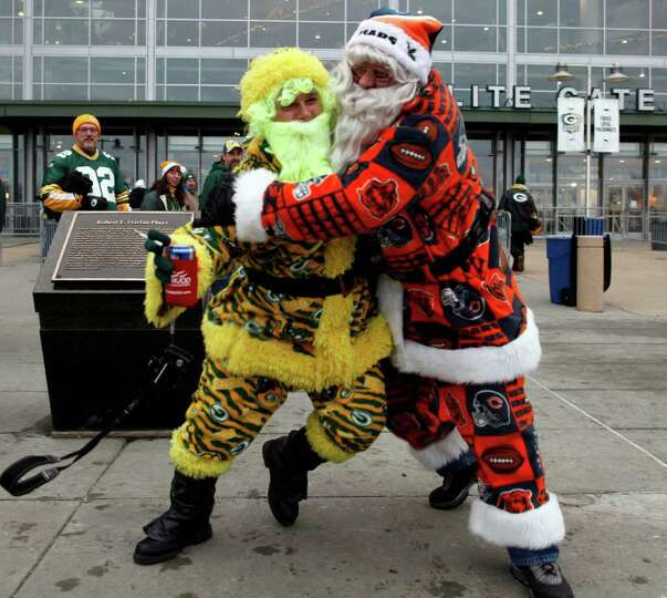 Ryan Schaffer, left, and Dan Freese have some fun outside Lambeau Field before an NFL football game