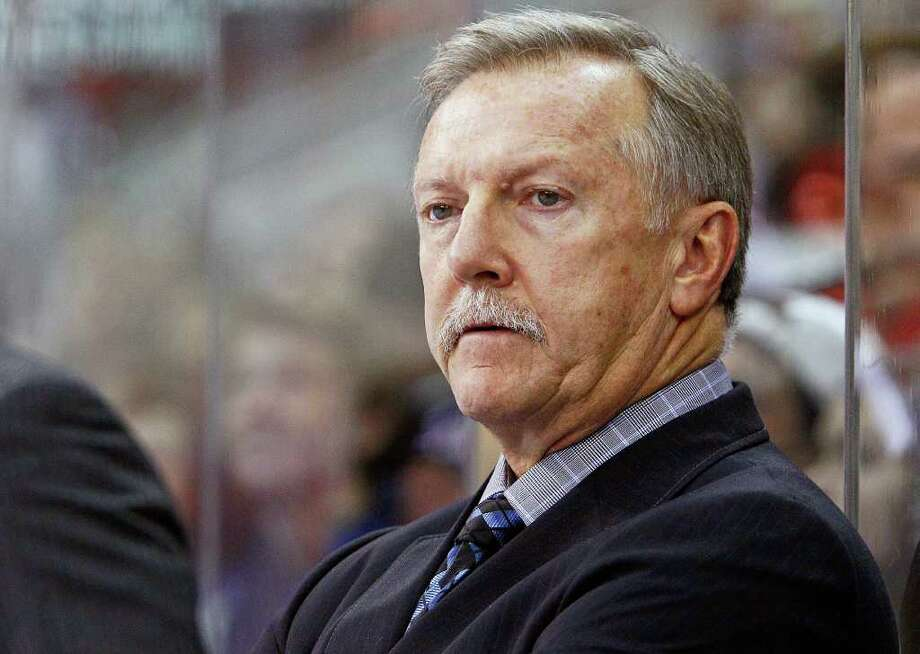 FILE - In this Nov. 20, 2011, file photo, Toronto Maple Leafs head coach Ron Wilson looks on during the first period of an NHL hockey game against the Carolina Hurricanes in Raleigh, N.C.  Wilson has gotten his Christmas wish. Two days after hinting on Twitter of his desire for a new contract, Wilson said on Sunday, Dec. 25, on Twitter, the team has given him an extension. (AP Photo/Karl B DeBlaker, File) Photo: Karl B DeBlaker