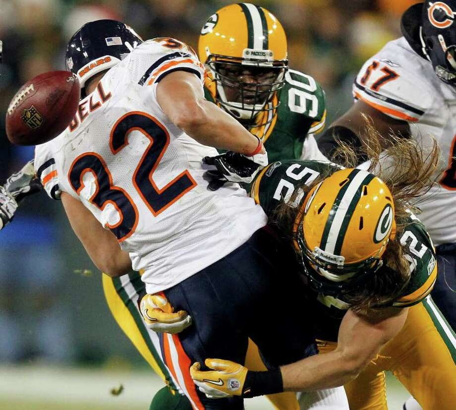 The Green Bay Packers loosen the ball from a Chicago Bears runner in the highly rated NFL Sunday game. Photo: Associated Press, Jeffrey Phelps