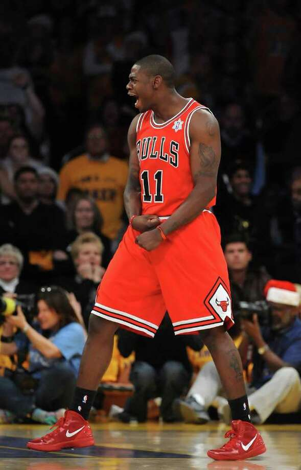 LOS ANGELES, CA - DECEMBER 25:  Ronnie Brewer #11 of the Chicago Bulls celebrates defeating the Los Angeles Lakers 88-87 at Staples Center on December 25, 2011 in Los Angeles, California.  NOTE TO USER: User expressly acknowledges and agrees that, by downloading and or using this photograph, User is consenting to the terms and conditions of the Getty Images License Agreement.  (Photo by Lisa Blumenfeld/Getty Images) Photo: Lisa Blumenfeld
