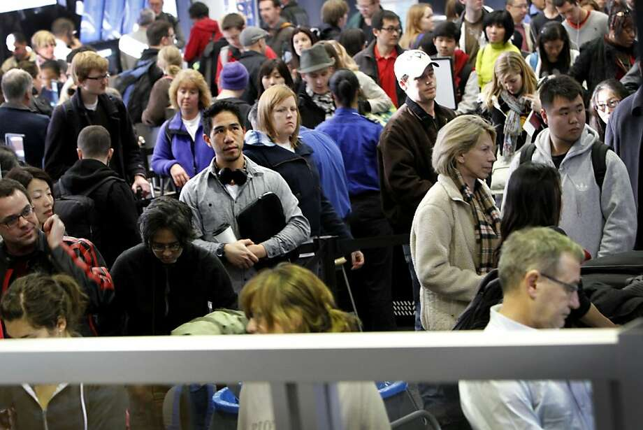 Travelers wait in line to enter a security checkpoint at San Francisco International Airport in San Francisco, Calif., Wednesday, December 21, 2011. Photo: Sarah Rice, Special To The Chronicle