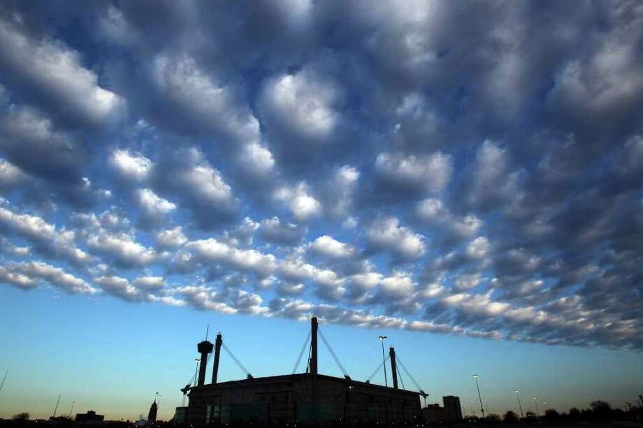 A line of clouds moves over the Alamodome and downtown San Antonio Monday December 26, 2011. Tuesday's forecast calls for clear skies and temperatures ranging from the 30s to the mid 60s.  JOHN DAVENPORT/jdavenport@express-news.net Photo: Express-News File Photo