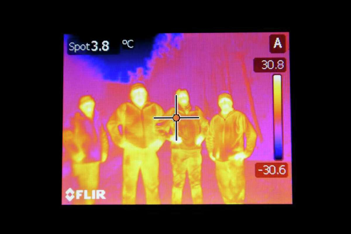 """Animal Planet's Finding Bigfoot team, Matt Moneymaker, from left, James """"Bobo"""" Fay, Cliff Barackman and Ranae Holland, use many techniques, including thermal detection, to search for the legendary creature."""