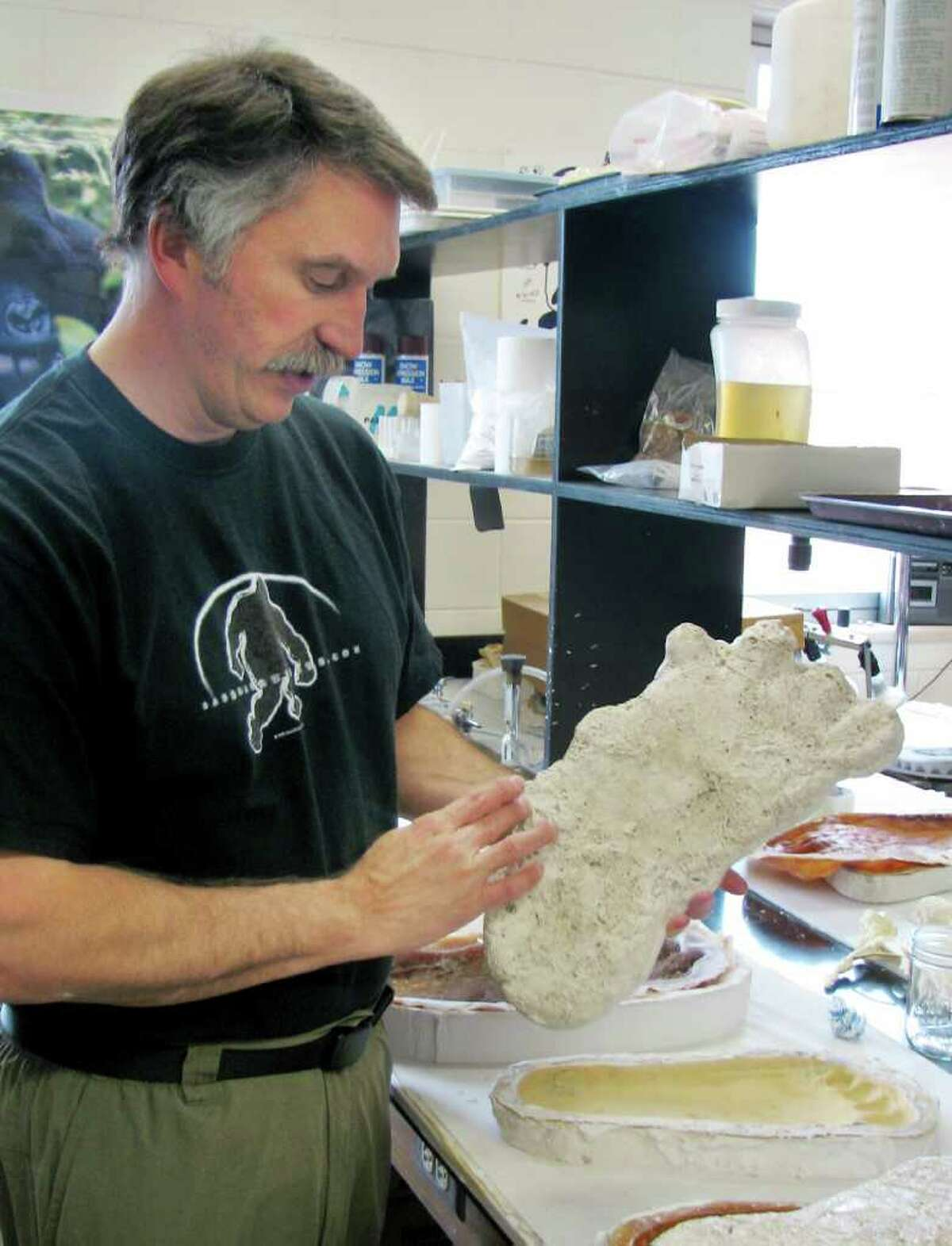 Jeffrey Meldrum displays what he describes as a casting of a footprint from a Bigfoot creature, taken in the Blue Mountains of eastern Washington, in his laboratory at Idaho State University in Pocatello in a Sept. 19, 2006, file photo. Meldrum holds a Ph.D. in anatomical sciences and is a tenured professor of anatomy at the school, and also one of the world's foremost expert on Bigfoot, the mythical smelly ape-man of the Northwest woods.