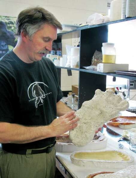 Jeffrey Meldrum displays what he describes as a casting of a footprint from a Bigfoot creature, take