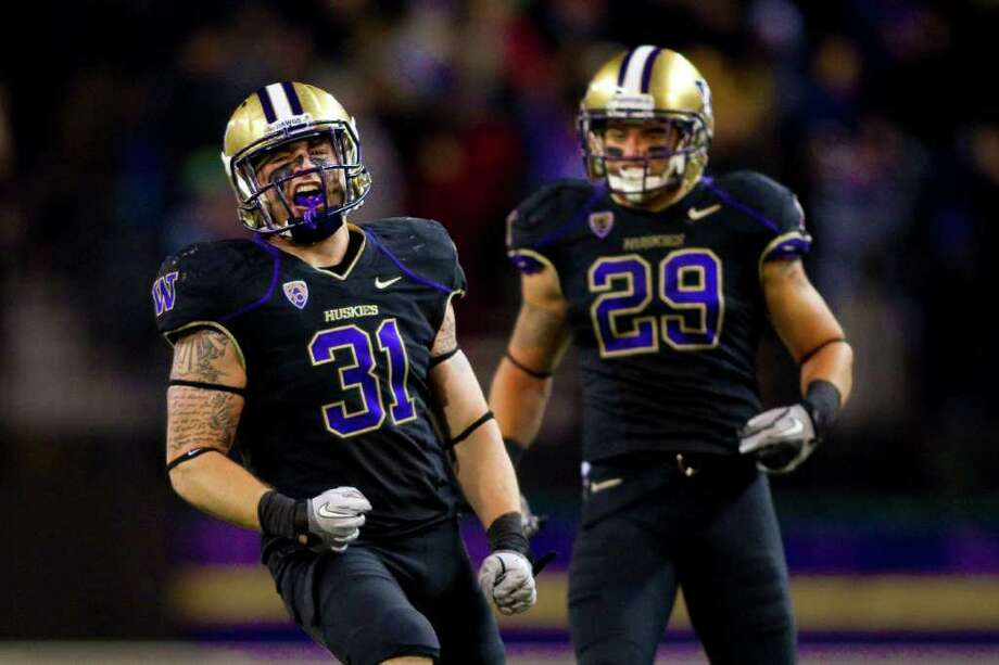 Washington linebacker Cort Dennison (left), the Huskies' defensive MVP, is ready for the challenge of Baylor's high-octane offense. Photo: COURTESY PHOTO, UNIVERSITY OF WASHINGTON / Red Box Pictures 3131 Western Ave Suite 323 Seattle, WA 98121 206-724-8241