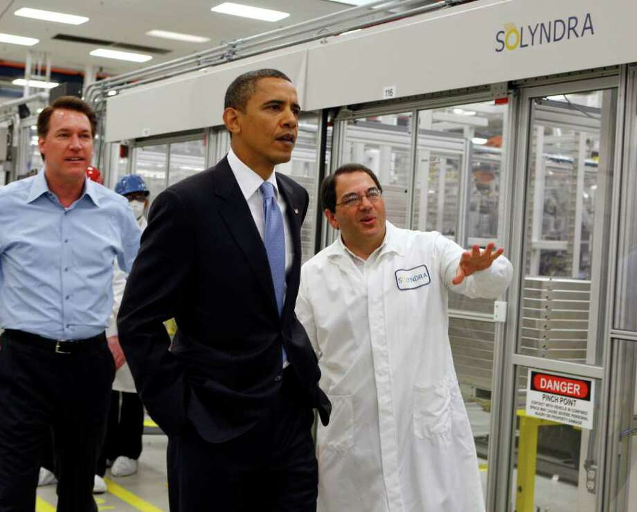 PAUL CHINN : ASSOCIATED PRESS FILE EXECUTIVE TOUR:  President Barack Obama was given a tour of Solyndra by Executive Vice President Ben Bierman, right, and Chief Executive Officer Chris Gronet on May 25, 2010. Photo: Paul Chinn / AP2010