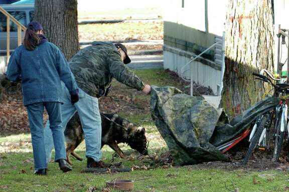 Garry and Pam Hammer of the Orange Township Search and Rescue has their dog that is trained to smell body remains search Northway mobile home park near Diebold Road and North Clinton Street in Fort Wayne, Ind. on Monday, Dec. 26, 2011. The Hammers, part of State of Indiana District 3 SAR K9 team, are involved in the continued search for Aliahna Lemmon, who has been missing since Friday. (AP Photo/The Journal-Gazette, Cathie Rowand)  NEWS-SENTINEL OUT