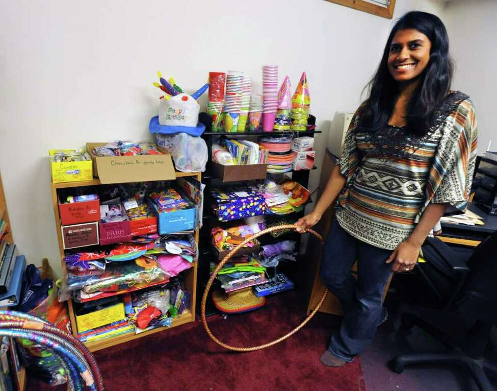 Fazana Saleem-Ismail stands in her basement full of party supplies and toys for homeless children on Friday, Dec. 23, 2011 in Schenectady, N.Y. (Lori Van Buren / Times Union)