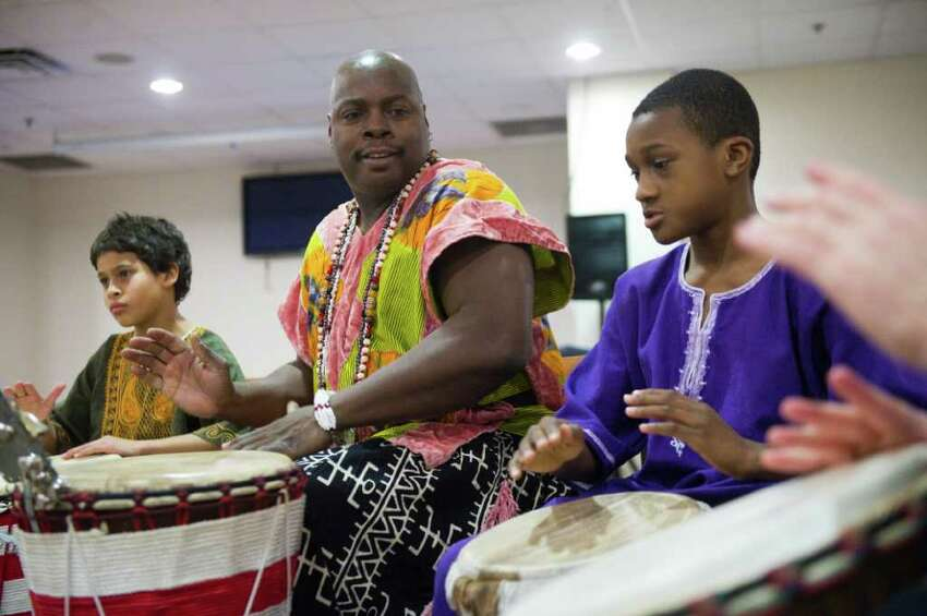 Brother Henry Jones leads the Infinite Roots Ethnic Drumming and Dance Troupe as Stamford Kwanzaa Association celebrates its 11th Annual Umoja (Unity) Community Celebration kicking off the week of Kwanzaa at the Faith Tabernacle Baptist Church in Stamford, Conn., December 26, 2011. The Stamford Kwanzaa celebrations will continue with events each day beginning Tuesday at 2 with the film, The Black Candle, at the Ferguson Library South End Branch. Wednesday features two events focusing on collective work and responsibility, one at the Government Center at 2 and a second at Bethel A.M.E. Church at 6:30 P.M. Thursday, the focus will be collective economics at the Chester Addison Community Center at 5 P.M. And Friday at noon, purpose will be the topic at CTE, Inc., on Woodland Avenue. The week's events are co-sponsored by the Friends of the Ferguson Library, the Community Arts Partnership Program and the City of Stamford. For more information about these events, contact Josephine Fulcher-Anderson at (203) 351-8280.