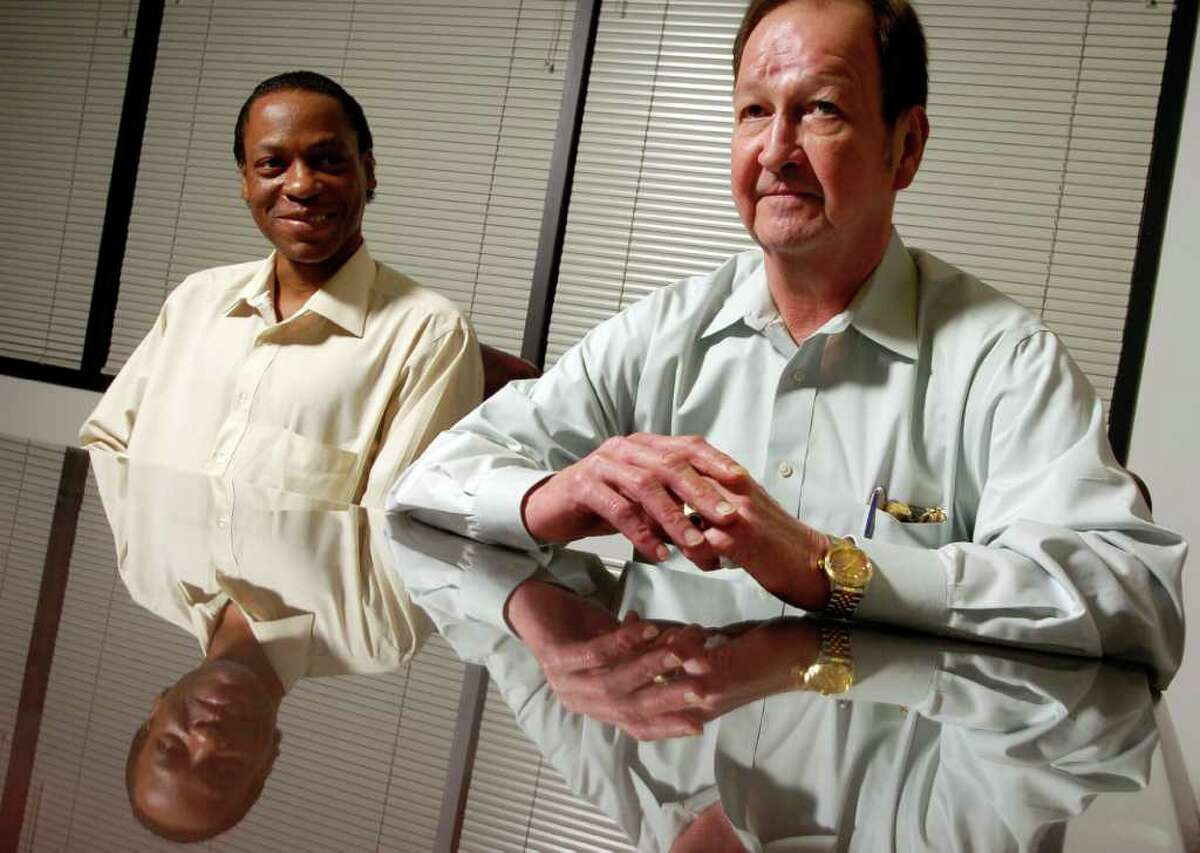 CHRISTOBAL PEREZ : CHRONICLE FILE REFLECTING: John Lawrence, right, and Tyron Garner discuss their experience in an interview in Houston lawyer Mitchell Katine's office in April 2004, almost a year after the Supreme Court ruled that states may not criminalize private homosexual conduct.