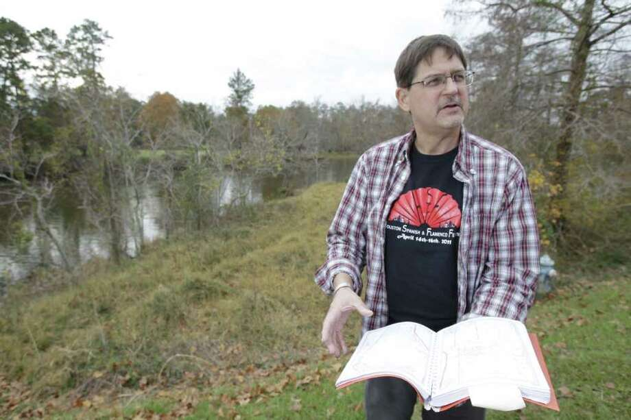 Melissa Phillip : Chronicle AN ENDLESS CYCLE?: Brandt Mannchen of the Houston Sierra Club, standing in an area upstream of the proposed canal that would bring Trinity water to Lake Houston, says the project continues an endless cycle of increasing water supply to meet growing demands. Photo: Melissa Phillip / © 2011 Houston Chronicle