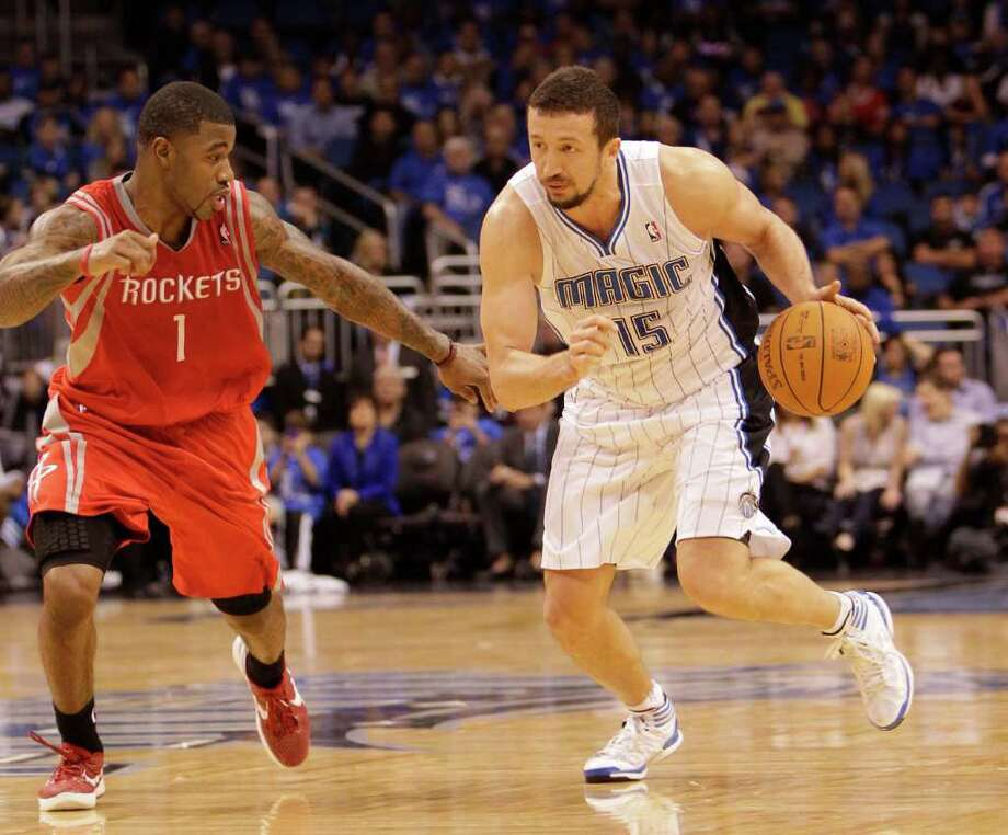 Orlando Magic's Hedo Turkoglu, of Turkey, (15) drives past Houston Rockets' Terrence Williams (1) during the second half of an NBA basketball game Monday, Dec. 26, 2011, in Orlando, Fla. Orlando won 104-95.(AP Photo/John Raoux) Photo: John Raoux, Associated Press / AP