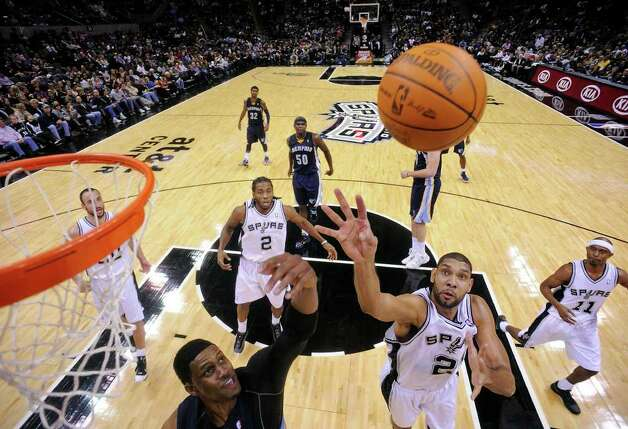 Memphis Grizzlies' Rudy Gay and San Antonio Spurs' Tim Duncan grab for a rebound during second half action Monday Dec. 26, 2011 at the AT&T Center. The Spurs won 95-82. Photo: EDWARD A. ORNELAS, Express-News / SAN ANTONIO EXPRESS-NEWS (NFS)