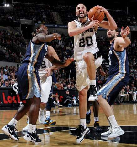 San Antonio Spurs' Manu Ginobili is fouled by Memphis Grizzles' Jeremy Pargo (left) as he drives past Memphis Grizzles' Marc Gasol during second half action Monday Dec. 26, 2011 at the AT&T Center. The Spurs won 95-82. Photo: EDWARD A. ORNELAS, Express-News / SAN ANTONIO EXPRESS-NEWS (NFS)