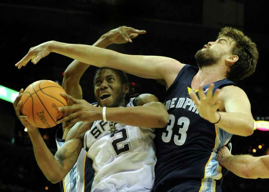 Kawhi Leonard (2) of the San Antonio Spurs is fouled by Marc Gasol (33) of the Memphis Grizzlies during NBA action at the AT&T Center on Monday, Dec. 26, 2011. BILLY CALZADA / gcalzada@express-news.net  Memphis Grizzlies at San Antonio Spurs Photo: BILLY CALZADA, Express-News / gcalzada@express-news.net
