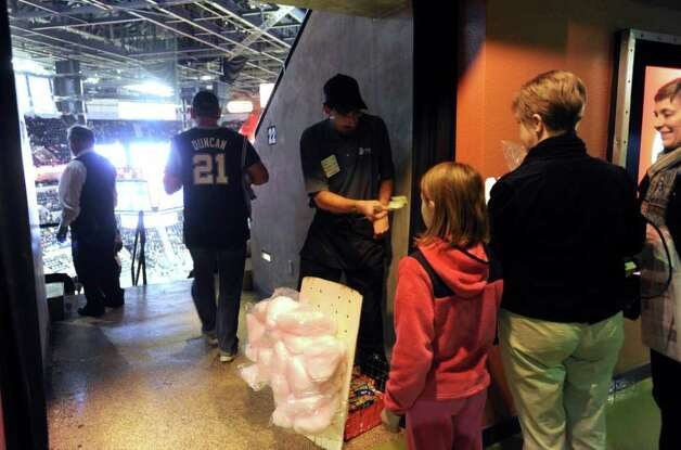 People buy cotton candy before the San Antonio Spurs' opening game of the season at the AT&T Center on Monday, Dec. 26, 2011. BILLY CALZADA / gcalzada@express-news.net