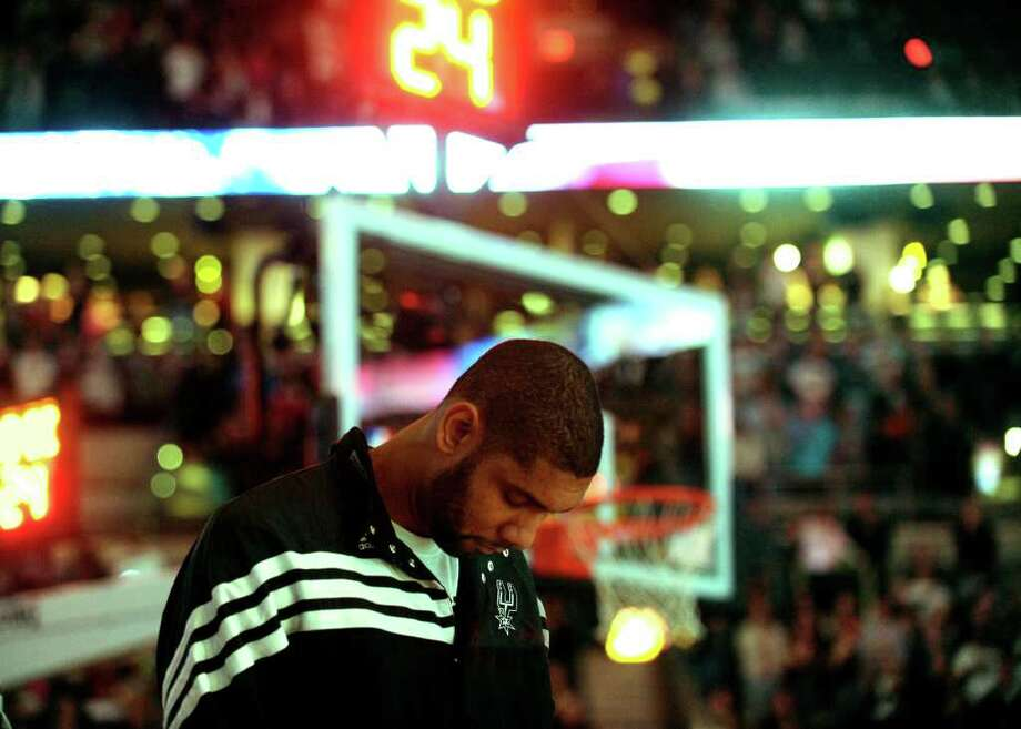Tim Duncan of the San Antonio Spurs stands firm during the playing of the Star-Spangled banner prior to NBA action against the Memphis Grizzlies at the AT&T Center on Monday, Dec. 26, 2011. BILLY CALZADA / gcalzada@express-news.net  Memphis Grizzlies at San Antonio Spurs Photo: BILLY CALZADA, Express-News / gcalzada@express-news.net