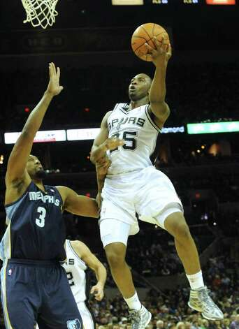 James Anderson (45) of the Spurs shoots a left-handed layup against Memphis during NBA action at the AT&T Center on Monday, Dec. 26, 2011. BILLY CALZADA / gcalzada@express-news.net