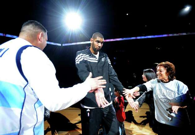 Tim Duncan of the San Antonio Spurs is greeted by fans as he is introduced before NBA action against the Memphis Grizzlies at the AT&T Center on Monday, Dec. 26, 2011. BILLY CALZADA / gcalzada@express-news.net