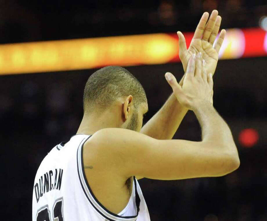 Tim Duncan of the San Antonio Spurs applauds his teammates during NBA action against the Memphis Grizzlies at the AT&T Center on Monday, Dec. 26, 2011. BILLY CALZADA / gcalzada@express-news.net