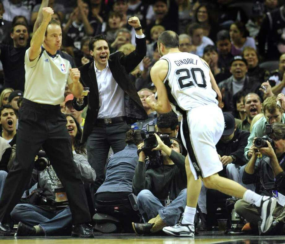 A fan celebrates after Manu Ginobili (20) of the San Antonio Spurs scored as he was fouled during second-half NBA action against the Memphis Grizzlies at the AT&T Center on Monday, Dec. 26, 2011. The Spurs won, 95-82. BILLY CALZADA / gcalzada@express-news.net  Memphis Grizzlies at San Antonio Spurs Photo: BILLY CALZADA, Express-News / gcalzada@express-news.net