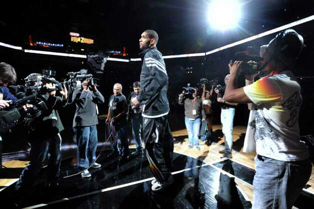 Tim Duncan of the San Antonio Spurs, entering his 15th NBA season, is introduced at the AT&T Center prior to the opening game of the 2011-2012 season. The Spurs beat the Memphis Grizzlies, 95-82. Dec. 26, 2011. BILLY CALZADA / gcalzada@express-news.net  Photo: BILLY CALZADA, Express-News / gcalzada@express-news.net