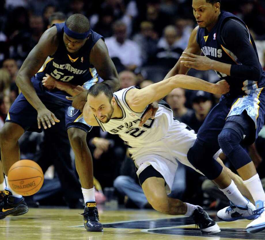 Manu Ginobili of the San Antonio Spurs is determined as he chases a loose ball against Zach Randolph, left, and Rudy Gay, right, of the Memphis Grizzlies during second-half NBA action at the AT&T Center on Monday, Dec. 26, 2011. The Spurs won, 95-82. BILLY CALZADA / gcalzada@express-news.net  Memphis Grizzlies at San Antonio Spurs Photo: BILLY CALZADA, Express-News / gcalzada@express-news.net