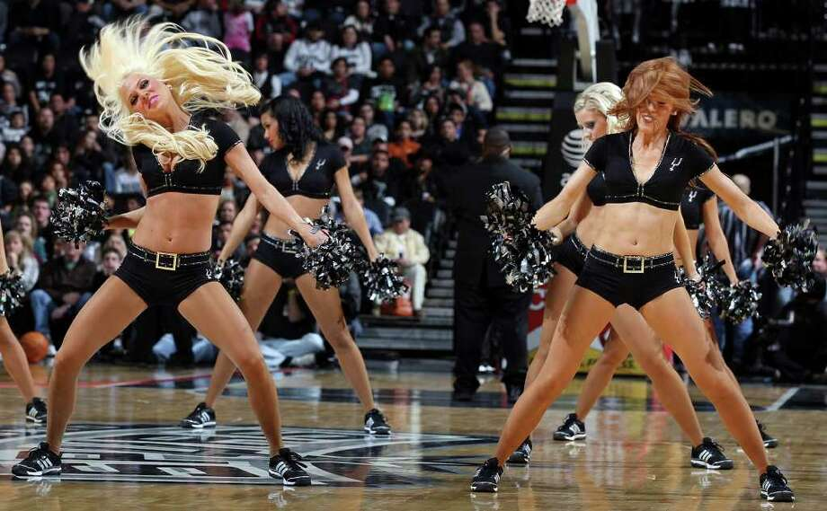 Members of the San Antonio Spurs Silver Dancers perform during the game with the Memphis Grizzles Monday Dec. 26, 2011 at the AT&T Center. The Spurs won 95-82. Photo: EDWARD A. ORNELAS, Express-News / SAN ANTONIO EXPRESS-NEWS (NFS)