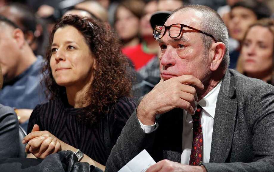 Actor Tommy Lee Jones and his wife Dawn Laurel watch the San Antonio Spurs and Memphis Grizzlies game Monday Dec. 26, 2011 at the AT&T Center. Photo: EDWARD A. ORNELAS, Express-News / SAN ANTONIO EXPRESS-NEWS (NFS)