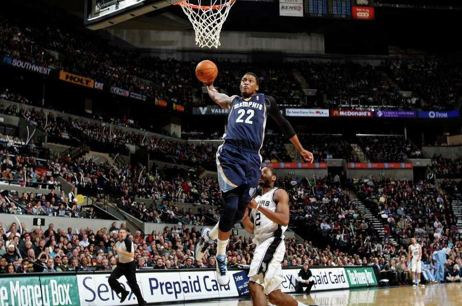 Memphis Grizzlies' Rudy Gay goes up for a dunk ahead of San Antonio Spurs' Kawhi Leonard  during first half action Monday Dec. 26, 2011 at the AT&T Center. Photo: EDWARD A. ORNELAS, Express-News / SAN ANTONIO EXPRESS-NEWS (NFS)