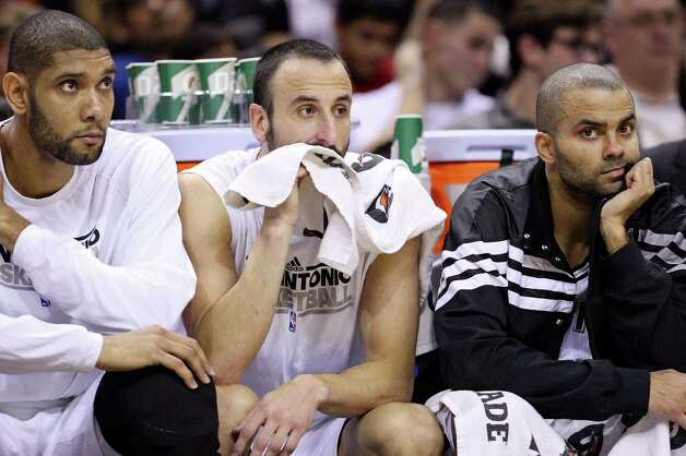 San Antonio Spurs' Tim Duncan (from left), San Antonio Spurs'  Manu Ginobili and San Antonio Spurs' Tony Parker  watch first half action from the bench against Memphis Grizzlies Monday Dec. 26, 2011 at the AT&T Center. Photo: EDWARD A. ORNELAS, Express-News / SAN ANTONIO EXPRESS-NEWS (NFS)