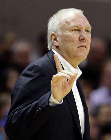 San Antonio Spurs head coach Gregg Popovich calls a play against the Memphis Grizzlies during first half action Monday Dec. 26, 2011 at the AT&T Center. Photo: EDWARD A. ORNELAS, Express-News / SAN ANTONIO EXPRESS-NEWS (NFS)