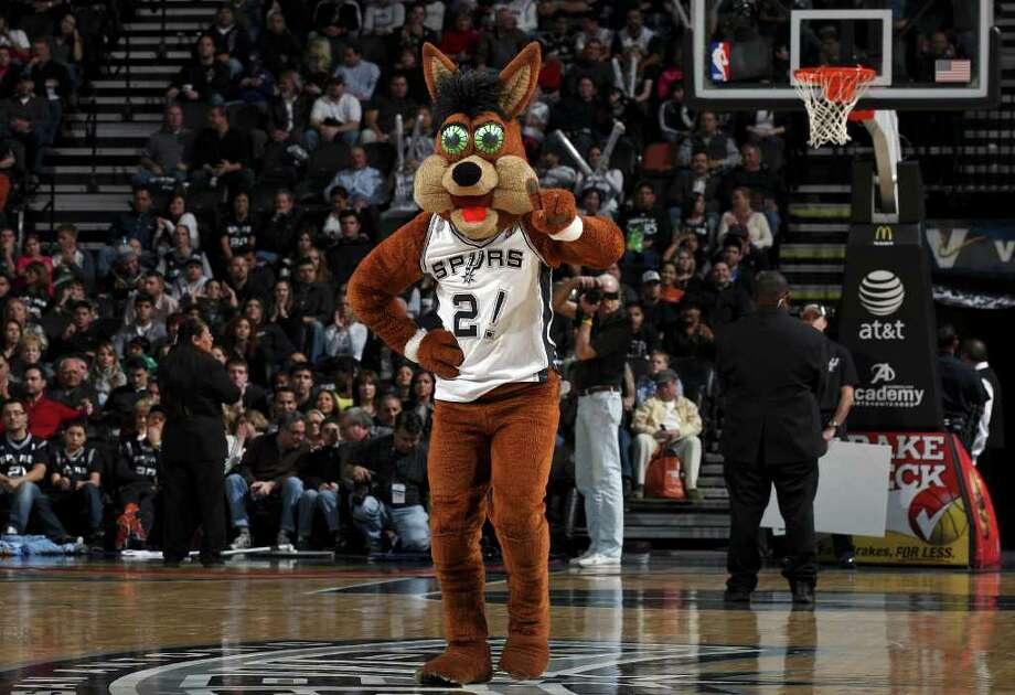 The San Antonio Spurs Coyote performs during the game with the Memphis Grizzlies Monday Dec. 26, 2011 at the AT&T Center. The Spurs won 95-82. Photo: EDWARD A. ORNELAS, Express-News / SAN ANTONIO EXPRESS-NEWS (NFS)