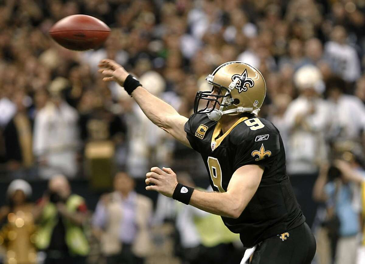 New Orleans Saints quarterback Drew Brees throws a touchdown pass during the fourth quarter of an NFL football game against the Atlanta Falcons in New Orleans, Monday, Dec. 26, 2011. With the pass, Brees set an NFL record for passing yardage in a season. (AP Photo/Rusty Costanza)