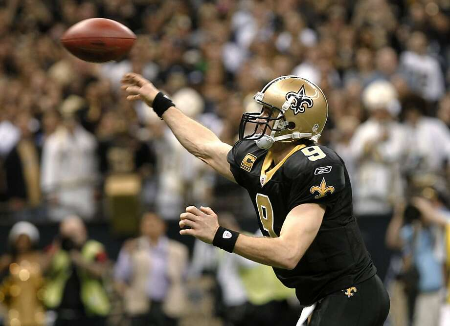 New Orleans Saints quarterback Drew Brees throws a touchdown pass during the fourth quarter of an NFL football game against the Atlanta Falcons in New Orleans, Monday, Dec. 26, 2011. With the pass, Brees set an NFL record for passing yardage in a season. (AP Photo/Rusty Costanza) Photo: Rusty Costanza, Associated Press