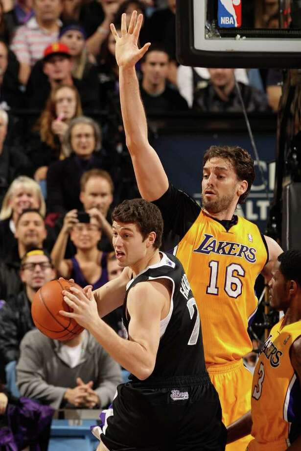 SACRAMENTO, CA - DECEMBER 26:  Jimmer Fredette #7 of the Sacramento Kings drives on Pau Gasol #16 of the Los Angeles Lakers at Power Balance Pavilion on December 26, 2011 in Sacramento, California.  NOTE TO USER: User expressly acknowledges and agrees that, by downloading and or using this photograph, User is consenting to the terms and conditions of the Getty Images License Agreement.  (Photo by Ezra Shaw/Getty Images) Photo: Ezra Shaw